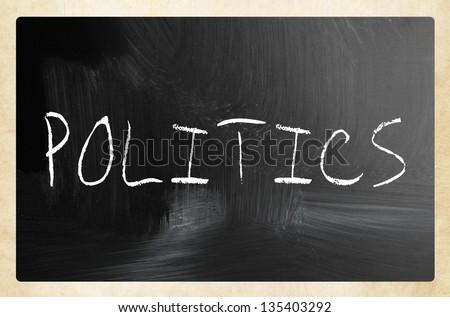 The word 'Politics' handwritten with white chalk on a blackboard - stock photo