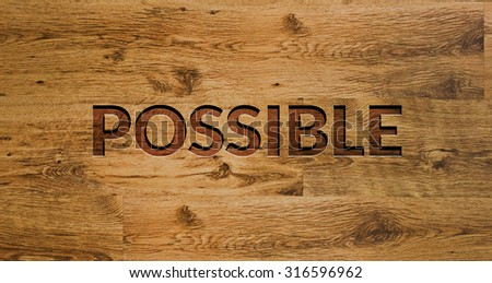 The word POSSIBLE Engraved in Wooden Background. - stock photo