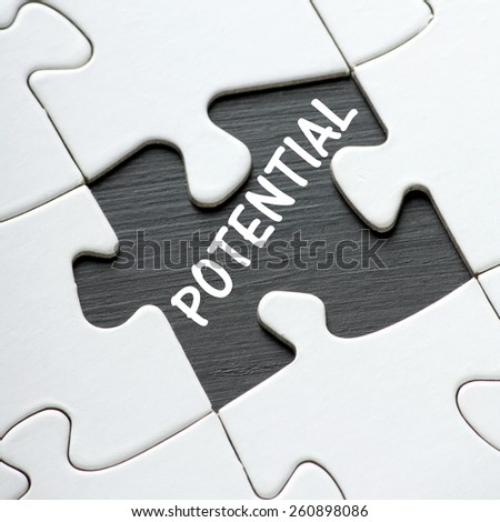 The word POTENTIAL revealed on a blackboard by a missing jigsaw puzzle piece - stock photo