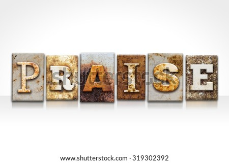 "The word ""PRAISE"" written in rusty metal letterpress type isolated on a white background. - stock photo"
