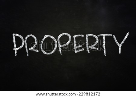 The word Property written with chalk on blackboard