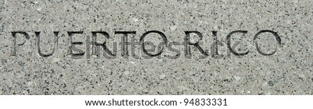 "The word ""Puerto Rico"" carved into granite"