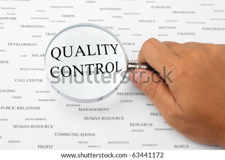 The word QUALITY CONTROL is magnified. - stock photo