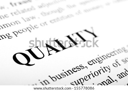 The word quality shot with artistic selective focus. - stock photo