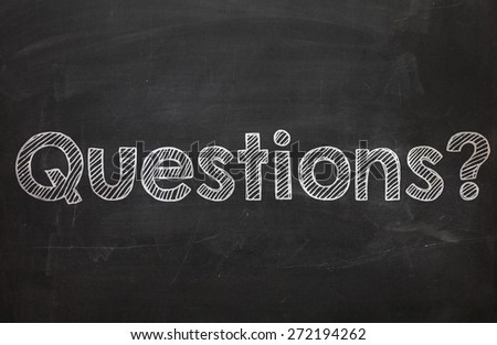The word Questions handwritten with white chalk on a blackboard - stock photo