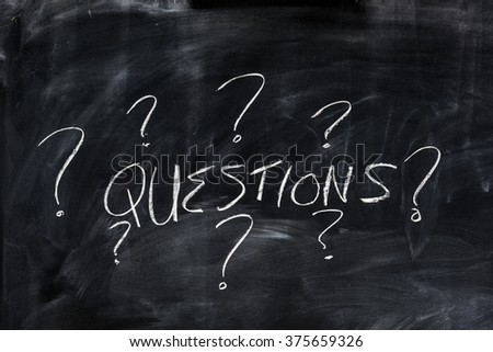 "The word ""Questions"" written on on a chalk board"