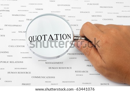 The word QUOTATION is magnified. - stock photo