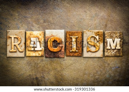 "The word ""RACISM"" written in rusty metal letterpress type on an old aged leather background. - stock photo"