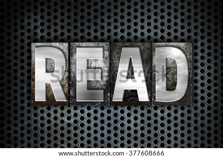 "The word ""Read"" written in vintage metal letterpress type on a black industrial grid background. - stock photo"