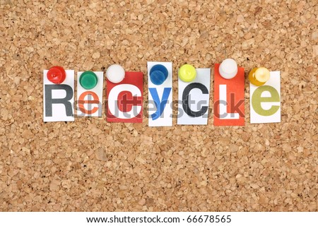 The word Recycle in cut out magazine letters pinned to a cork notice board