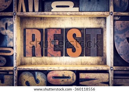 "The word ""Rest"" written in vintage wooden letterpress type. - stock photo"