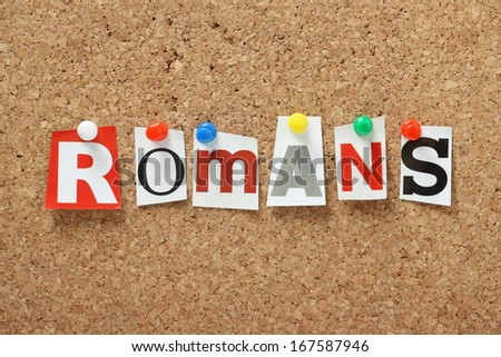 The word Romans, from the Old Testament of the Holy Bible in cut out magazine letters pinned to a cork notice board