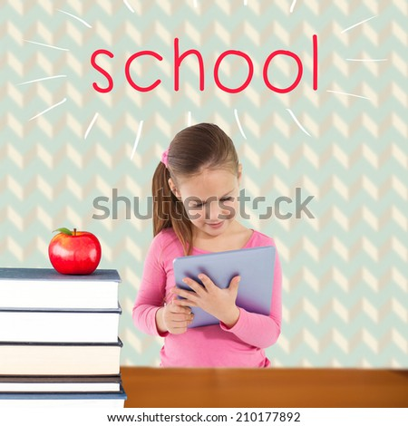 The word school and cute girl using tablet against red apple on pile of books - stock photo
