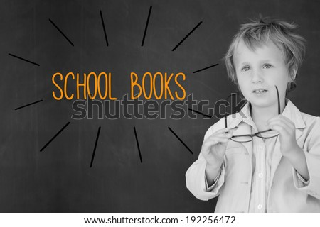 The word school books against schoolboy and blackboard - stock photo