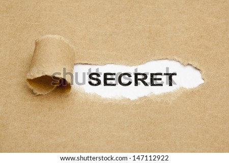 The word Secret appearing behind torn brown paper. - stock photo