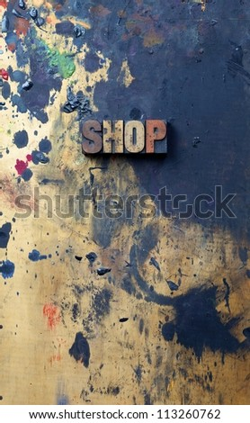 The word shop written in antique letterpress printing blocks. - stock photo
