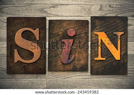 """The word """"SIN"""" written in wooden letterpress type. - stock photo"""