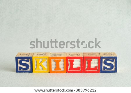 The word skills spelled with colorful alphabet blocks isolated against a white background - stock photo