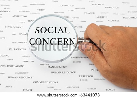 The word SOCIAL CONCERN is magnified.