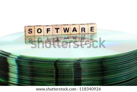 The word Software written in wooden letters standing on a computer-CD - stock photo