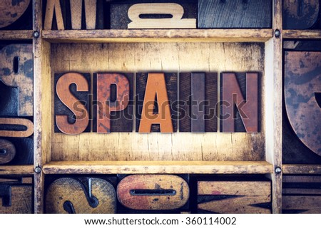 "The word ""Spain"" written in vintage wooden letterpress type."