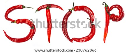 """The word """"STOP"""" composed of red chili peppers isolated on a white background - stock photo"""