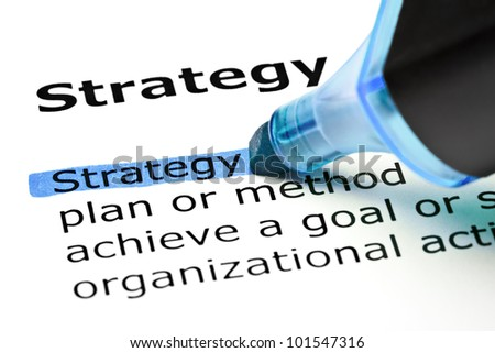 The word Strategy highlighted in blue with felt tip pen. - stock photo