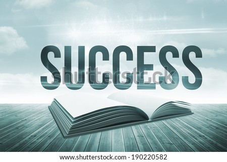 The word success against open book against sky