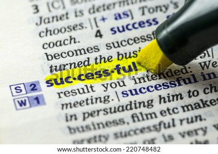 The word successful highlighted in dictionary with Marker Pen - stock photo