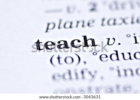 the word teach written in a thesaurus - stock photo