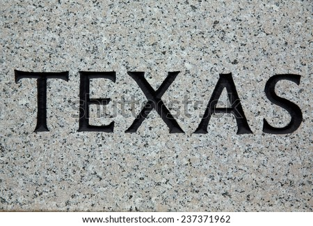 The word texas printed on Granite from the Texas State Capitol Building - stock photo