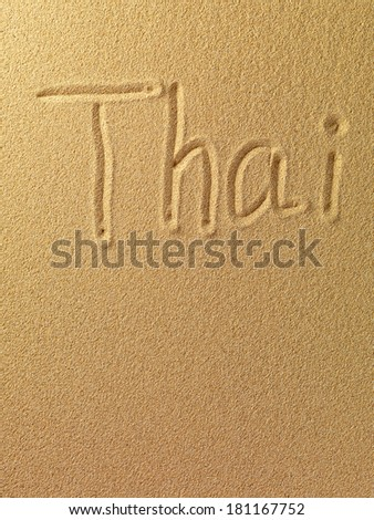 The word Thai is written on a sand background  - stock photo