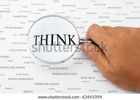 The word THINK is magnified. - stock photo