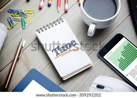 The word time and business graphs against notepad on desk - stock photo