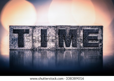 """The word """"TIME"""" written in vintage ink stained letterpress type. - stock photo"""