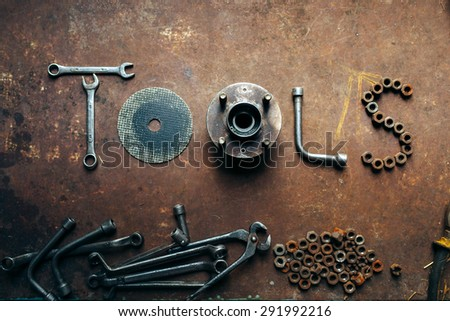 the word Tools made of the different tools lying on a rusty metal background. - stock photo