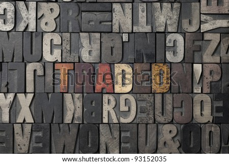 The word Traded written out in old letterpress blocks. - stock photo