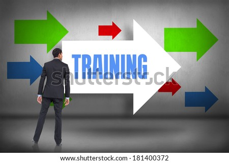 The word training and asian businessman against arrows pointing - stock photo