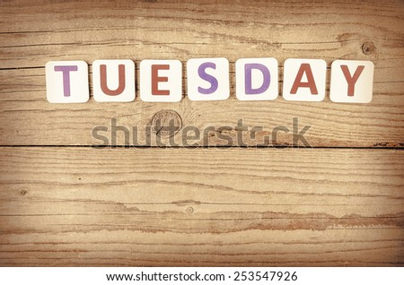 The word TUESDAY written in wooden letterpress type.