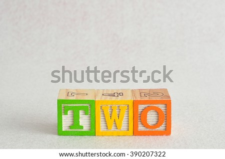The word two (2) spelled with colorful alphabet blocks isolated against a white background - stock photo