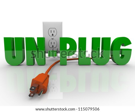 The word Unplug in green letters with an orange electrical cord disconnected from the power outlet - stock photo