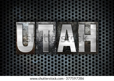 "The word ""Utah"" written in vintage metal letterpress type on a black industrial grid background."