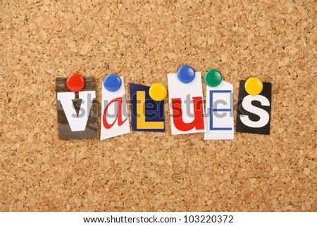 The word values in cut out magazine letters pinned to a cork notice board. May refer to social or business values. - stock photo