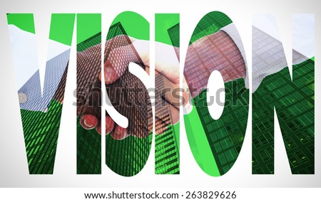The word vision and close-up shot of a handshake in office against skyscraper - stock photo