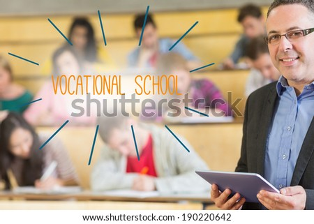 The word vocational school against lecturer standing in front of his class in lecture hall - stock photo