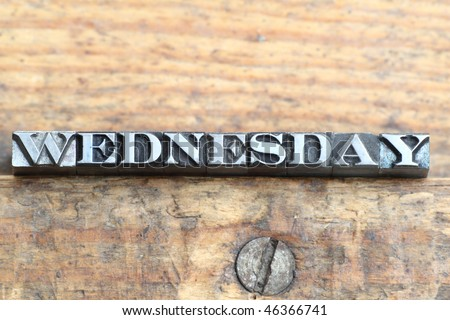 the word wednesday in letterpress type on a wooden background. - stock photo