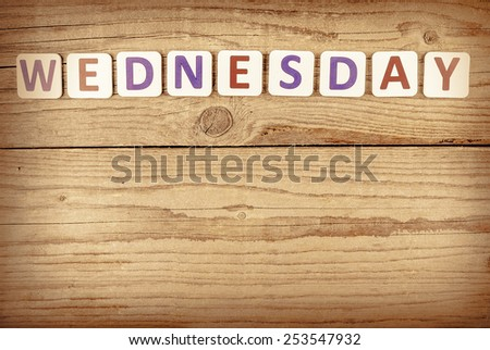 The word WEDNESDAY written in wooden letterpress type. - stock photo