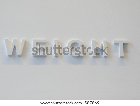 "The word ""weight"" embossed on a white wall, partially blurred"