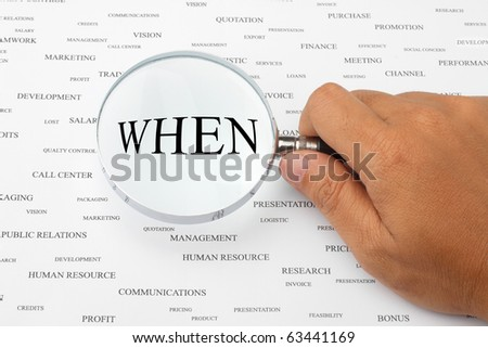 The word WHEN is magnified. - stock photo
