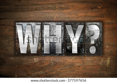 """The word """"Why"""" written in vintage metal letterpress type on an aged wooden background. - stock photo"""